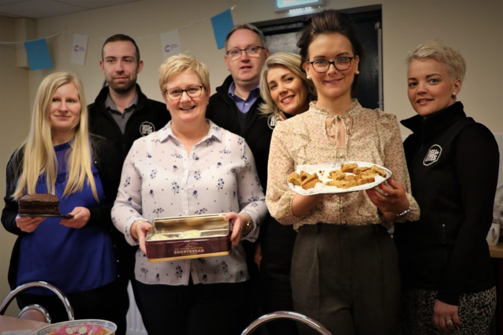 Iwona, Jacqueline and Jolene pivctured with their treats they baked for the coffee morning.