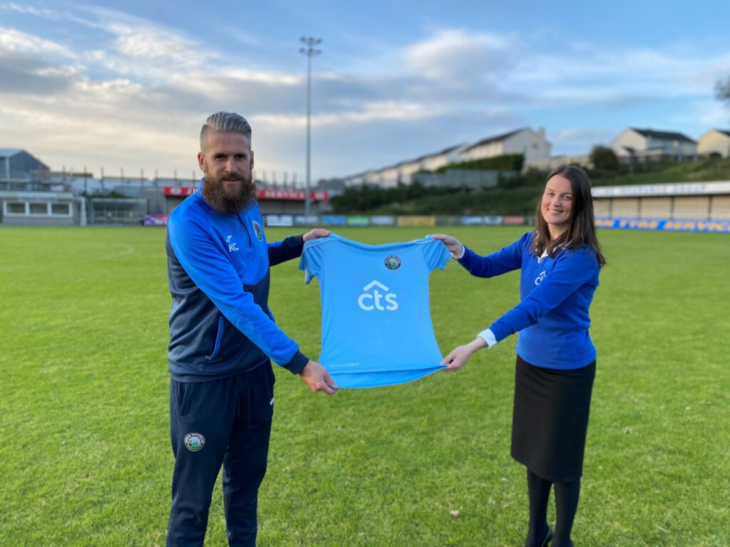 CTS member Serena presenting u14 Warrenpoint Town manager Kieran with new jerseys.