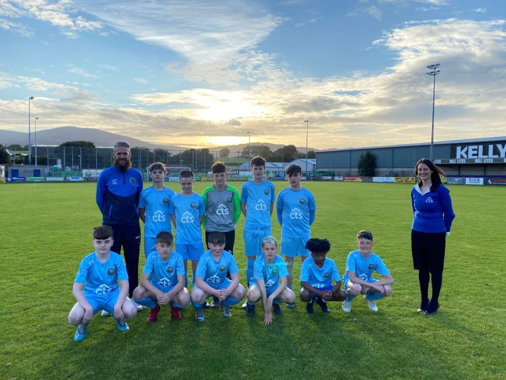 CTS member Serena pictured with the Warrenpoint Town under 14s in their new jerseys.